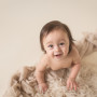 smiling baby on fur and blanket