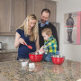 family baking cookies during maternity lifestyle session