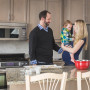 family in kitchen during maternity lifestyle session