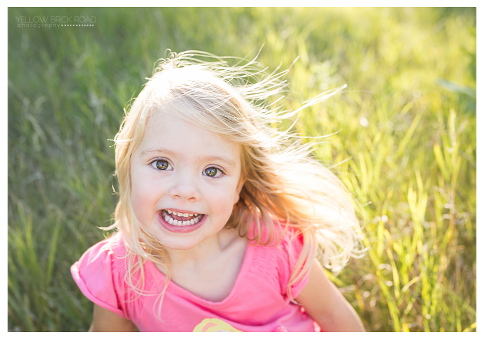 Blonde little girl smiling during photo session in Guelph