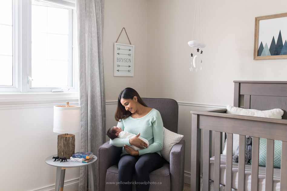 Waterloo Newborn Photographer mom and baby in nursery