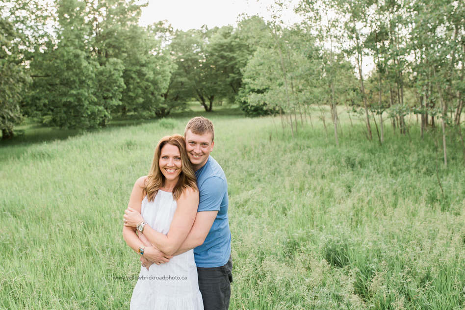 Family Photography in Guelph Happy couple posing in field