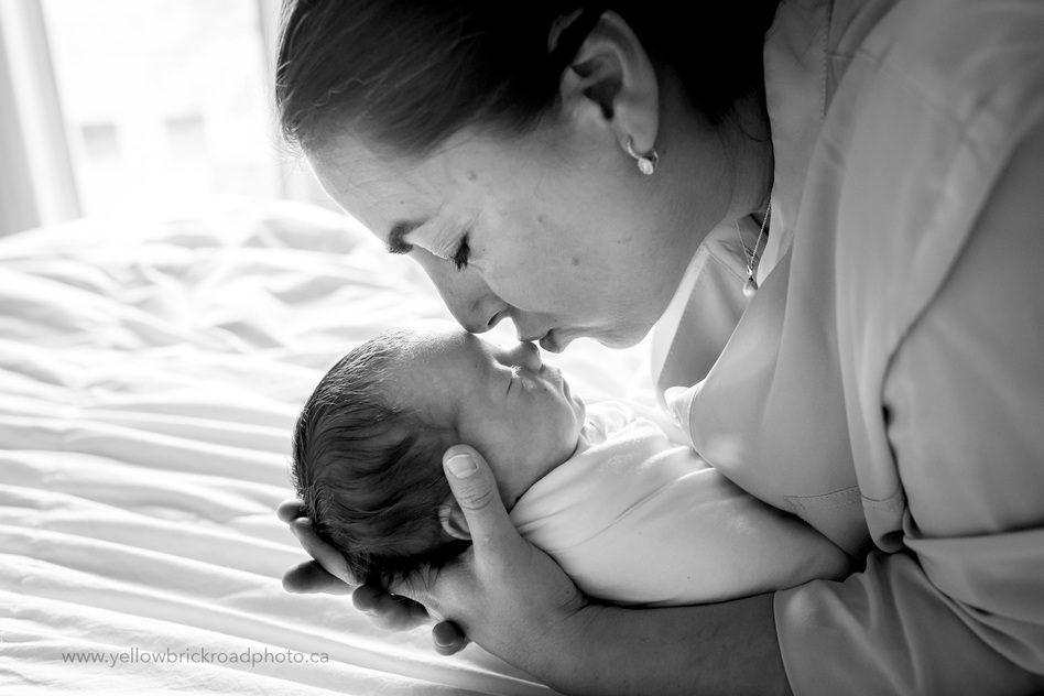 Toronto Newborn Lifestyle Photographer Mom kissing newborn