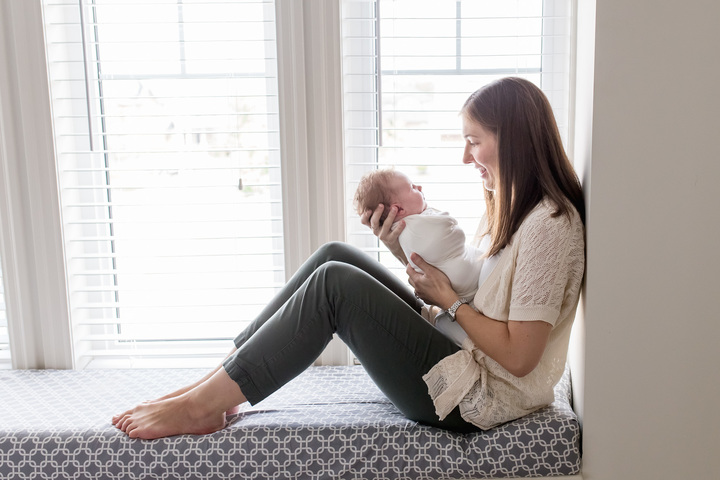 Guelph Home Newborn Photography Mom holding daughter