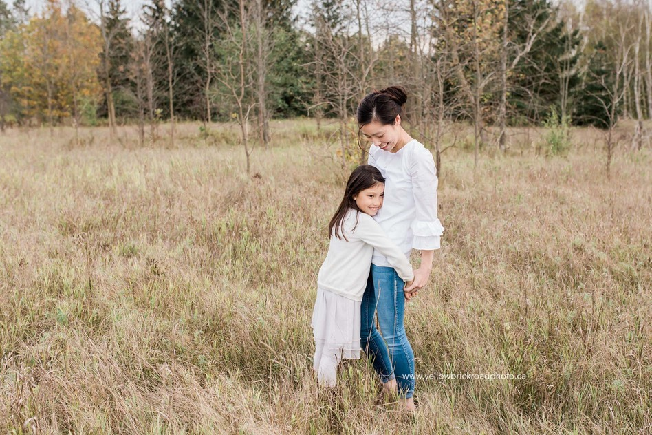 Fall Family Photography Mother and Daughter hugging in field
